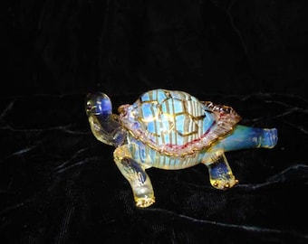 Hand blown glass turtle pipe.