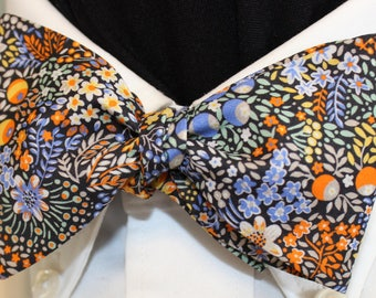 CORNUCOPIA: Made from Liberty of London color saturated cotton bow tie, handmade for well dressed men and women; blues, oranges, yellows