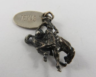Rodeo Rider on Bucking Bronco Horse With Texas Tag Attached Silver Charm of Pendant.