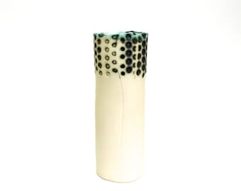 hand built porcelain vessel with dots