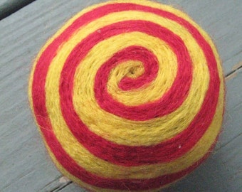 One multi-colored felted pin-cushion, Red and Yellow