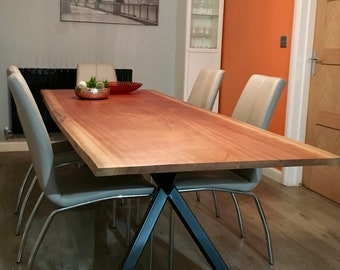 A Large Modern Dining Table Mounted on Stunning Contemporary Legs, Sculpted from a Single Slab of Brazilian Mahogany with a Live Edge