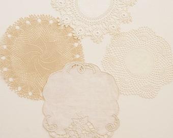four vintage lace doilies with unique contrast