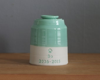 custom urn with ceramic lid, collared shape urn. custom name, color and text. pet urn or human urn. jade and white urn with quote shown.