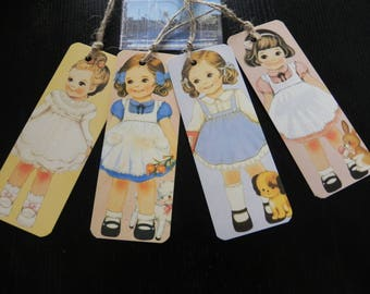 4 VINTAGE 5.5 effect tags x 14.5 cm representing a little girls
