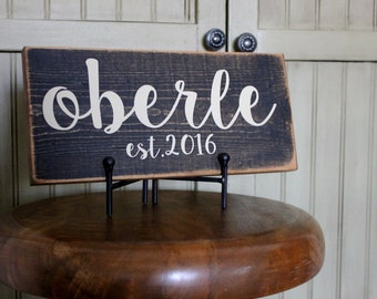 Rustic name sign and established wood sign