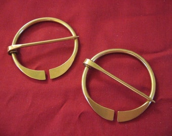 Pair of Small Penannular Brooches
