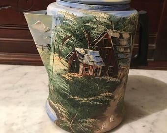 Peint le Pot de café à la main