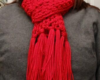 Bright red handmade scarf.