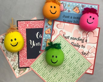 Share that Smile!  Send a note and stress ball, a Lara Bar, or a lip balm to let somebody know youre thinking about them. Custom message