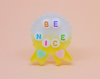 Be Nice, Resin Ribbon Badge, Pin or Keychain