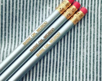 shine on, weirdo engraved pencils in silver. eccentrics are like stars, they brighten up a dark night.