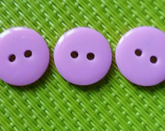 set of 3 round buttons of purple