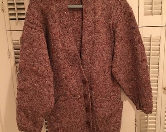 Hand knit women's long cardigan with pockets