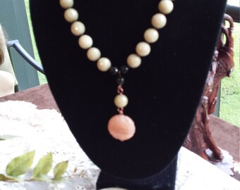One strand designer necklace with center drop