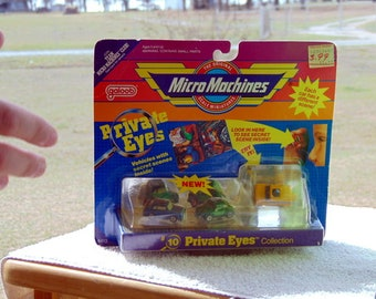 Micro machines private eyes collection #10 from 1989 - toyota MR-2 vw bug beetle.Never removed from packaging