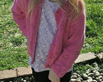 Pink knitted toddler sweater