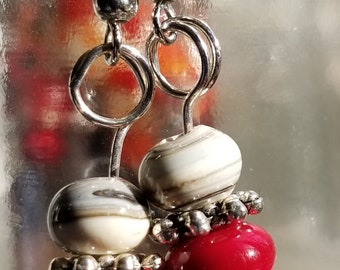 """Lampworked bead earrings with ruby red and off-white """"sediment"""" glass"""