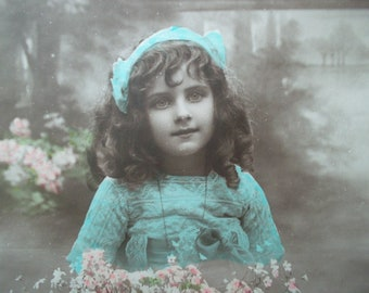 antique postcard of a little girl with lots of flowers