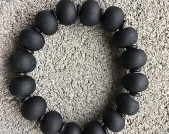 Unique handmade artisan glass bead bracelet, all black, mat finish. Strong elastic cord. We can adjust size.