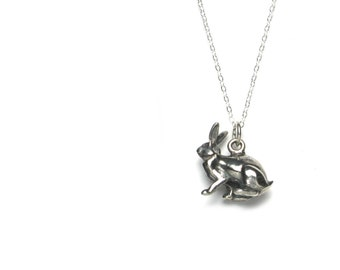 Solid sterling silver rabbit pendant or charm with antique patina.