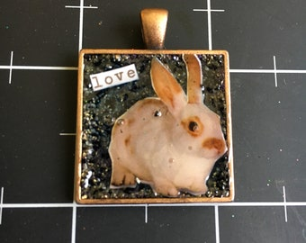 Love Bunny, blue glass glitter very lightly dusted with gold glitter, 50% of the proceeds go to the current selected animal charity