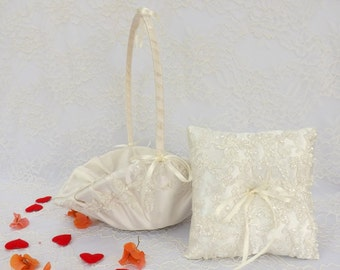 Flower girl basket and wedding ring pillow decorated with Ivory embroidered lace. Ivory flower girl basket set.