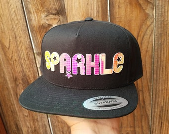 Sparkle Flat Brim Hat in Black with Super Reflective Writing and Snap Back Fit