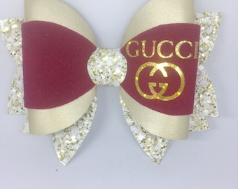 Large designer gold glitter and leatherette with cranberry suede