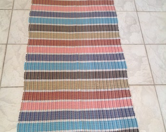 Beautiful completely handwoven as used on the loom rug with woven
