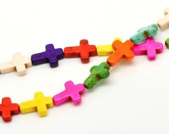 A Howlite bead, ivory cross.