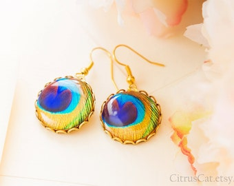 Golden peacock feather earrings