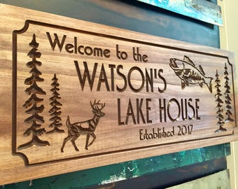Family Lake House sign, Welcome Signs Pine Tree Pine Cone Deer Fish Primitive wood carved Sign Wooden Carved Cabin Sign, Outdoor Wood Sign