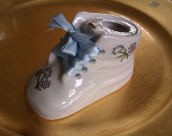 BABY BOOTIE HAS BLANK TO WRITE THE BABY'S NAME AND DATE OF BIRTH
