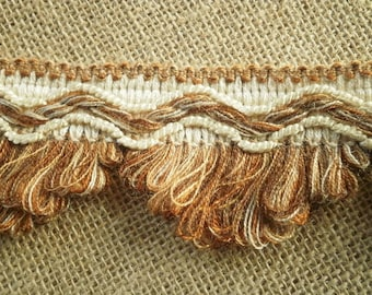 "Has fringe trim ""buckle"", acrylic, off-white, embroidered background in copper, beige and brown tones width 5.7"