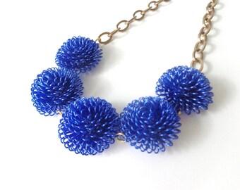 Blue statement necklace, metal flower necklace