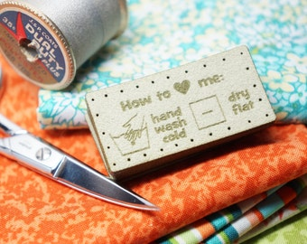 care labels with holes for easy attaching hand wash cold dry flat
