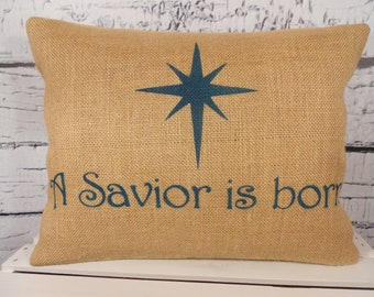 A Savior is born Christmas burlap pillow  with your choice of lettering color - A Savior is born and star