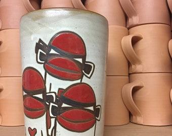 Sock monkey vase with three Ninja Sock Monkeys.