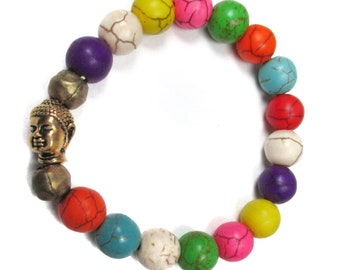 Multi colored 10mm round turquoise howlite stretch bracelet with brass Buddha head accent bead