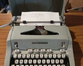 1969 Hermes 3000 portable typewriter with Script (cursive) font