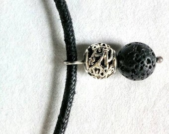 Lava stone with waxed cotton necklace.