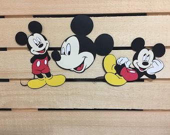 Set of 3 Mickey Mouse cutouts.