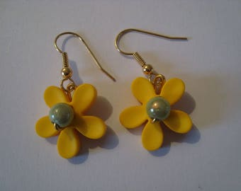 The pair of yellow and Green Flower Earrings