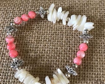 Coral and fresh water pearl beaded bracelet with silver accents.
