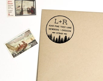 Circle return address stamp with pine trees and initials, self inking or wood handle rubber stamp