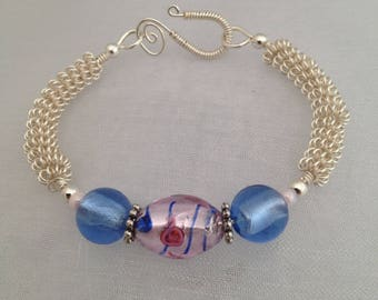 Silver wirework bracelet with pink and blue foil lampwork beads.