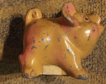Vintage Metal Cast Orange-Colored Piggy Bank