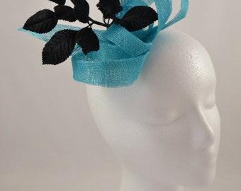 Aqua loops sinamay fascinator with black embellishment