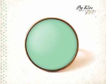 • Pantone hemlock color glass cabochon ring